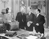 Greta Garbo as the newly arrived Commissar from Moscow confronts the three errant Commissars who preceded her on a government mission in MetroGoldwyn...