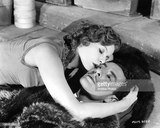 Greta Garbo kisses John Gilbert in a scene from the film 'Flesh And The Devil' 1927