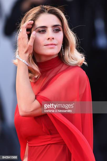 Greta Scarano walks the red carpet ahead of the 'Downsizing' screening and Opening Ceremony during the 74th Venice Film Festival at Sala Grande on...