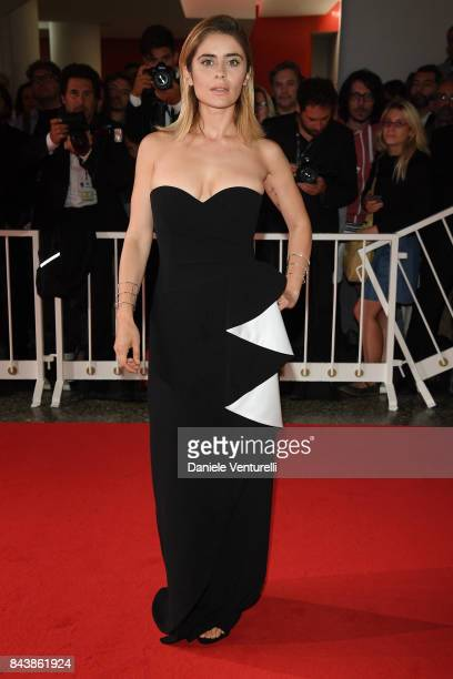 Greta Scarano walks the red carpet ahead of the 'Emma ' screening during the 74th Venice Film Festival at Sala Grande on September 7 2017 in Venice...