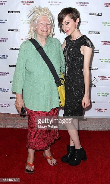 Gretchen Allison and Allisyn Ashley Arm arrive at Allisyn Ashley Arm Art Exhibit on August 30 2014 in Culver City California