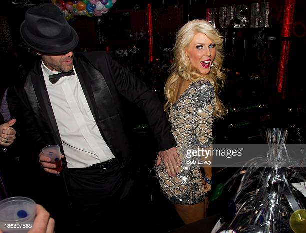 Gretchen Rossi receives a spank from boyfriend Slade Smiley at Drink Houston on December 31 2011 in Houston Texas