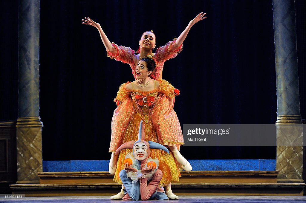 Gretel Palfrey and Alanze Lopez Extebarria as the step sisters and Matthew Koon as the Jester perform during the dress rehearsal for the English National Ballet's 'My First Cinderella' at The Peacock Theatre on March 26, 2013 in London, England.