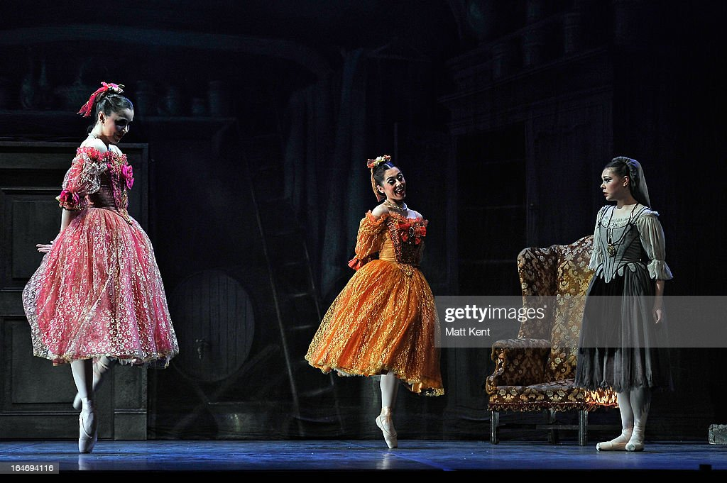 Gretel Palfrey and Alanze Lopez Extebarria perform as the step sisters and Daniela Oddi as Cinderella during the dress rehearsal for the English National Ballet's 'My First Cinderella' at The Peacock Theatre on March 26, 2013 in London, England.
