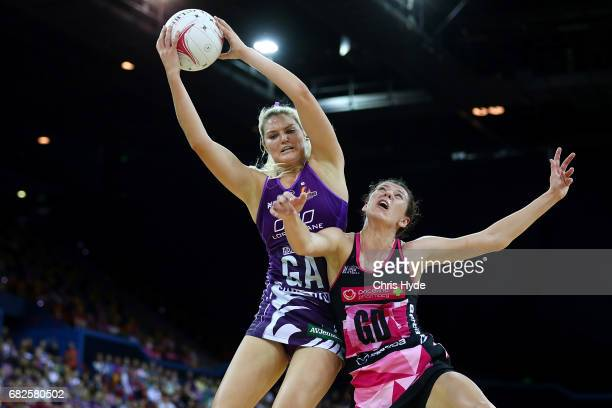 Gretel Tippett of the Firebirds takes a catch over Fiona Themann of the Thunderbirds during the round 12 Super Netball match between the Firebirds...