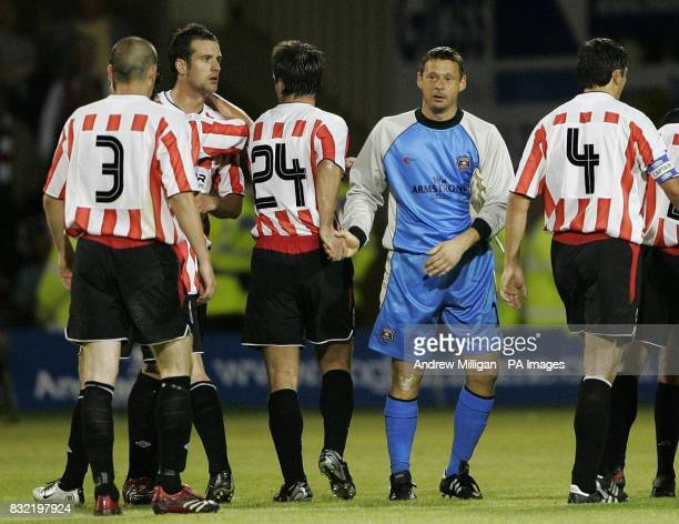 Gretna's Alan Main shows his dejection as Derry City celebrate their 51 win during the UEFA Cup second qualifying round first leg match at Fir Park...