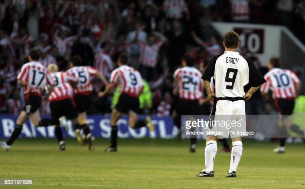Gretna's James Grady looks on as Derry City celebrate their goal during the UEFA Cup second qualifying round first leg match at Fir Park Motherwell