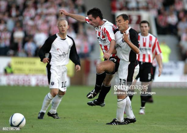 Gretna's James McQuilken challenges Derry City's Darren Kelly during the UEFA Cup second qualifying round first leg match at Fir Park Motherwell