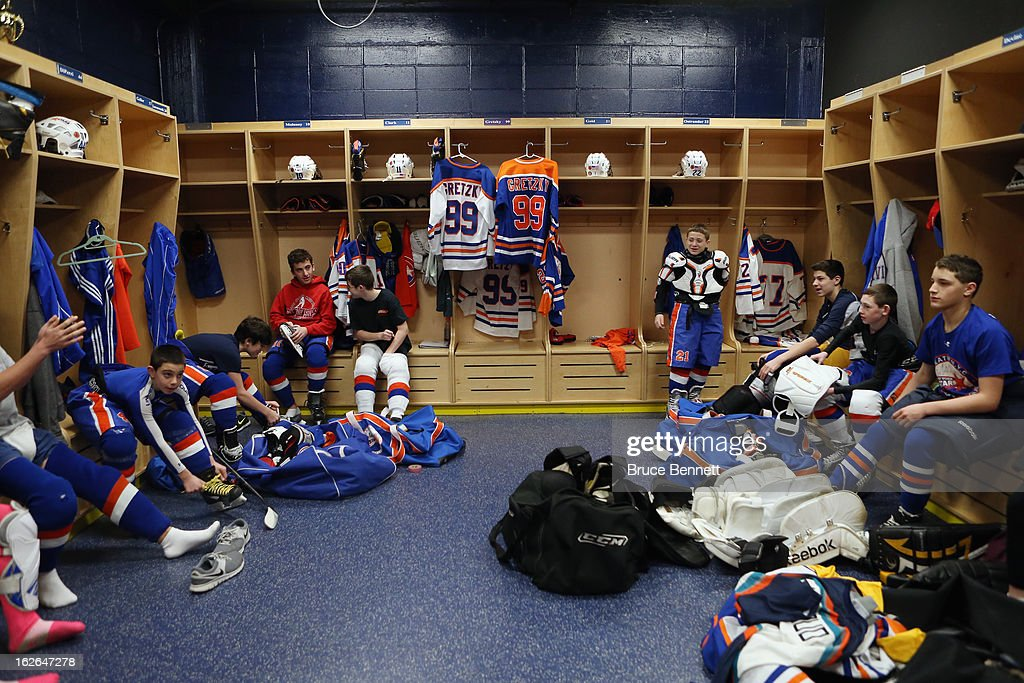 Gretzky jerseys hang in lockers as youth players get prepared for an appearance by Hockey Hall of Famer Wayne Gretzky at the Abe Stark Arena on February 25, 2013 in New York City. The event was organized by TD Bank who donated funds to the Greater New York City Ice Hockey League to replace equipment that was lost or destroyed during Superstorm Sandy.