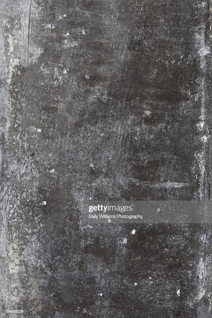 A grey, aged, corroded metal background