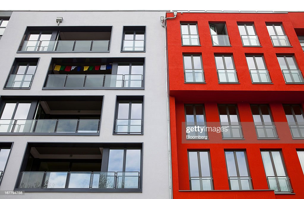 Grey and red paint covers the brightly colored exterior of a block of residential apartments located in the Mitte district of Berlin, Germany, on Monday, April 29, 2013. Rents and home prices in Germany's largest cities are rising at the fastest rate in twenty years, according to data compiled by Bulwien Gesa AG. Photographer: Krisztian Bocsi/Bloomberg via Getty Images