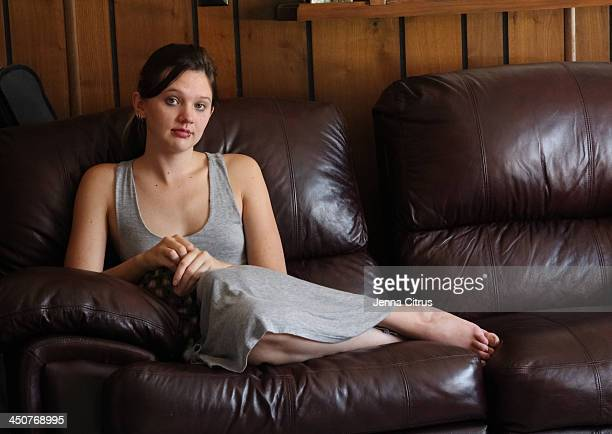 Grey Dressed Woman at Home on Her Couch