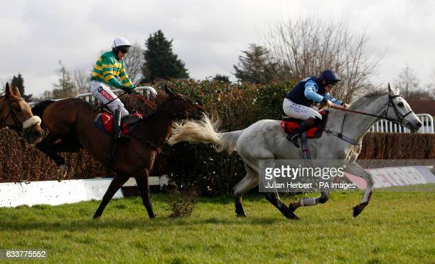 Grey Gold ridden by Jamie Moore leads Bold Henry ridden by Barry Geraghty over the last fence before going on to win The Betfred 'Treble Odds On...