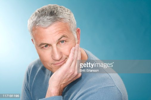 Grey hair man with head rest in hand