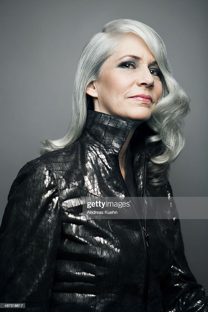 Grey haired lady in a stylish jacket, portrait.
