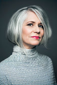 Grey haired lady with red lipstick, portrait.