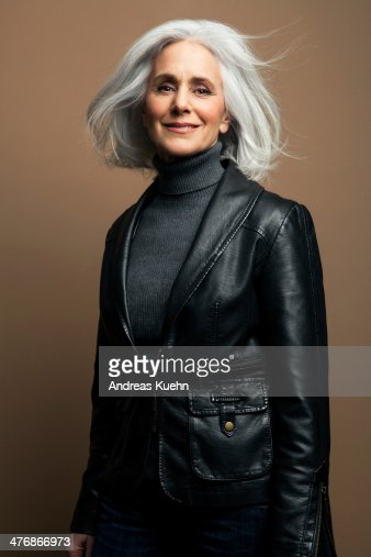 Grey Haired Mature Woman In Leather Jacket Stock Photo