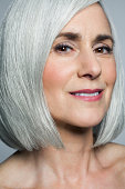 Grey haired mature woman with a bob, portrait.