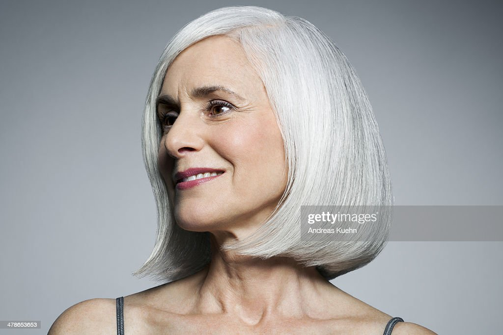 Grey haired woman in 3/4 postion, portrait.