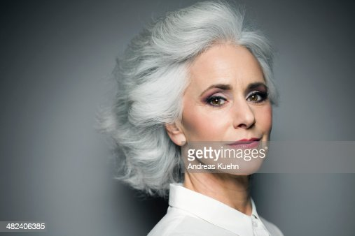 Grey haired woman with red lips, portrait.