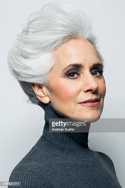 Grey haired woman with updo, portrait.