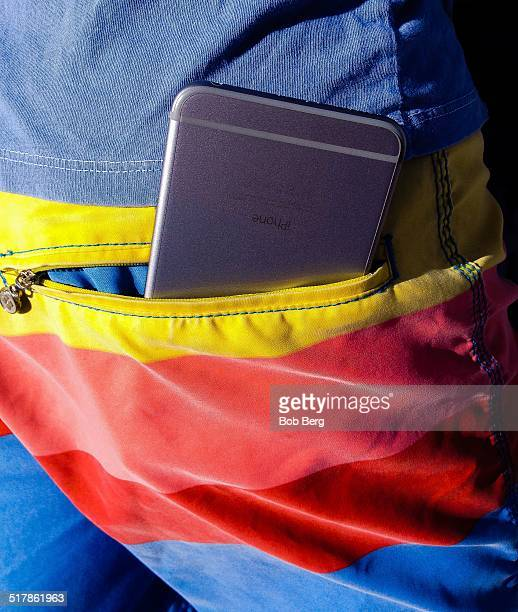 A grey iPhone 6 in the back pocket of a swimming suit