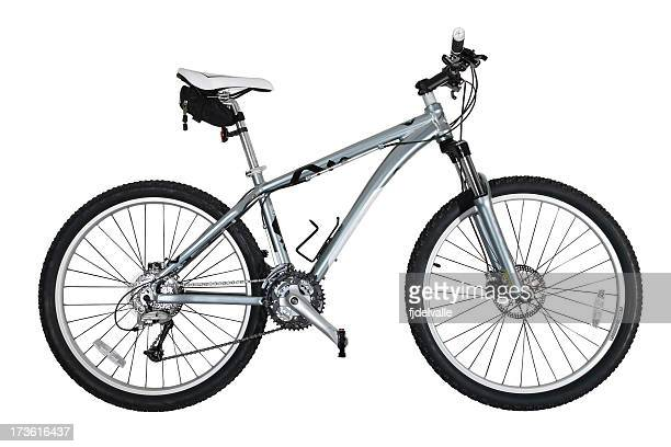 A grey mountain bicycle with black tires and white seat
