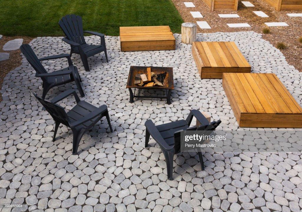 Grey Paving Stone Patio With Black Adirondack Sitting Chairs, Slightly  Raised Flat Rectangular Red Cedar