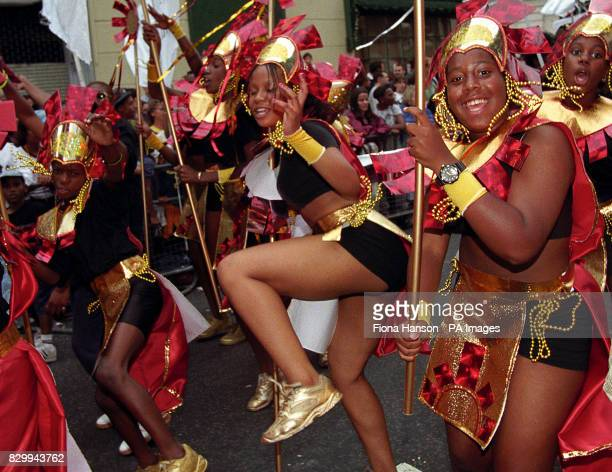 Grey skies failed to dampen the participants' party mood as the annual carnival processions took to the streets of Notting Hill