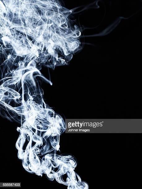 Grey  smoke on black background, studio shot
