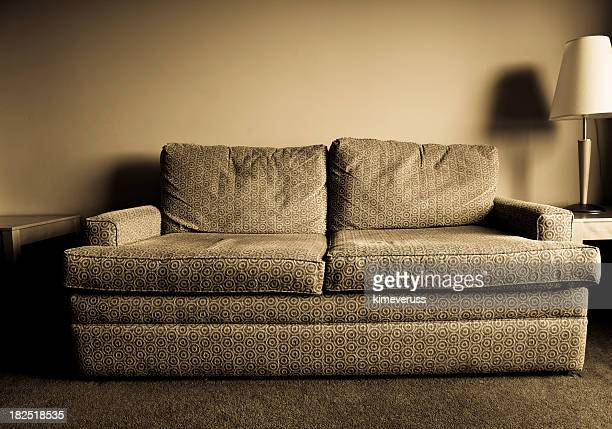 Greyscale old worn out hotel sofa in retro pattern