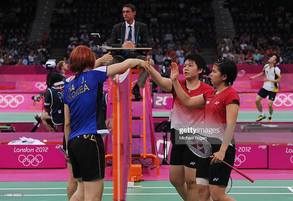 Greysia Polii and Meiliana Jauhari of Indonesia shake hands with Jung Eun Ha and Min Jung Kim of Korea in their Women's Doubles Badminton on Day 4 of the London 2012 Olympic Games at Wembley Arena on July 31, 2012 in London, England.