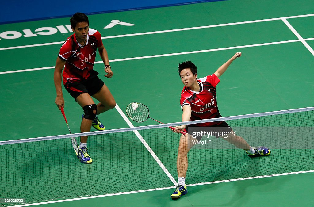 Greysia Polii of Indonesia hits a return next to her partner Nitya Krishna Maheswari during their mixed doubles match against Jung Kyung Eun and Shin Seung Chan of Korea at the 2016 Asia badminton championship in Wuhan,Hubei province, China, April 29, 2016.