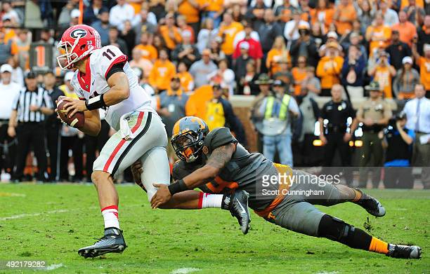 Greyson Lambert of the Georgia Bulldogs is sacked by Derek Barnett of the Tennessee Volunteers on October 10 2015 at Neyland Stadium in Knoxville...