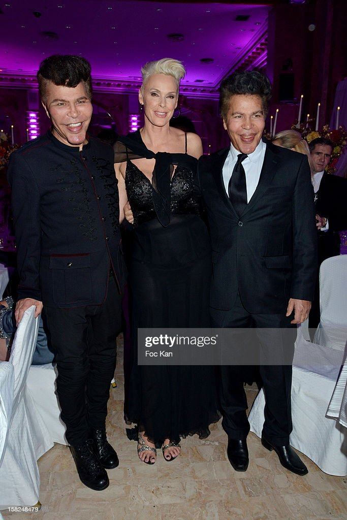 Grichka Bogdanoff, <a gi-track='captionPersonalityLinkClicked' href=/galleries/search?phrase=Brigitte+Nielsen&family=editorial&specificpeople=209264 ng-click='$event.stopPropagation()'>Brigitte Nielsen</a> and Igor Bogdanoff attend the The Bests Awards 2012 Ceremony at the Salons Hoche on December 11, 2012 in Paris, France.