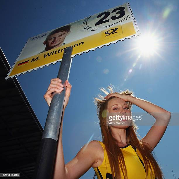 A grid girl is seen during the fifth round of the DTM German Touring Car Championship at Moscow Raceway on July 13 2014 in Moscow Russia
