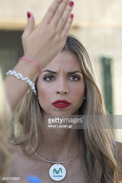 A grid girl looks on in paddock during the qualifying practice during the MotoGP of Spain Qualifying at Motorland Aragon Circuit on September 24 2016...