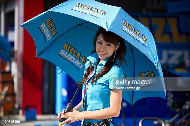 A grid girl of Rizla Suzuki MotoGP poses in the paddock before the qualifying practice of MotoGP of Japan at Twin Ring Motegi on October 2 2010 in...