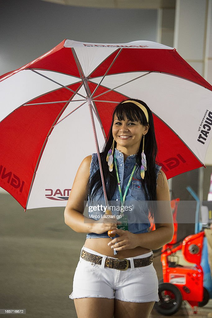 A grid girl poses in pit during the MotoGp of Qatar - Free Practice at Losail Circuit on April 5, 2013 in Doha, Qatar.