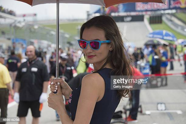 A grid girl poses on the grid during the MotoGP race during the MotoGp Red Bull US Grand Prix of The Americas Race at Circuit of The Americas on...