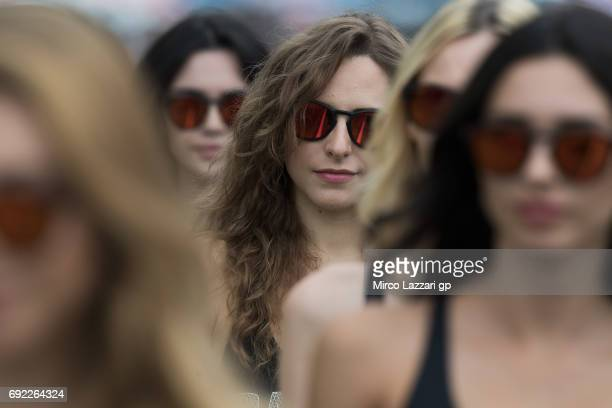 A grid girl poses on the grid during the MotoGP race during the MotoGp of Italy Race at Mugello Circuit on June 4 2017 in Scarperia Italy