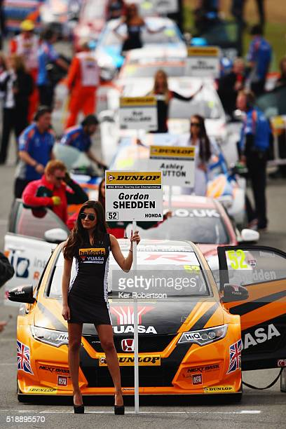 Grid girl stands in front of the car of Gordon Sheddon of Halfords Yuasa Honda before race two of the Dunlop MSA British Touring Car Championship at...