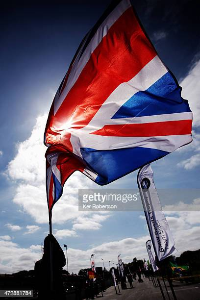 Grid girl waves a Union Jack Flag before the Blancpain GT Sprint Series race at Brands Hatch on May 10 2015 in Longfield England