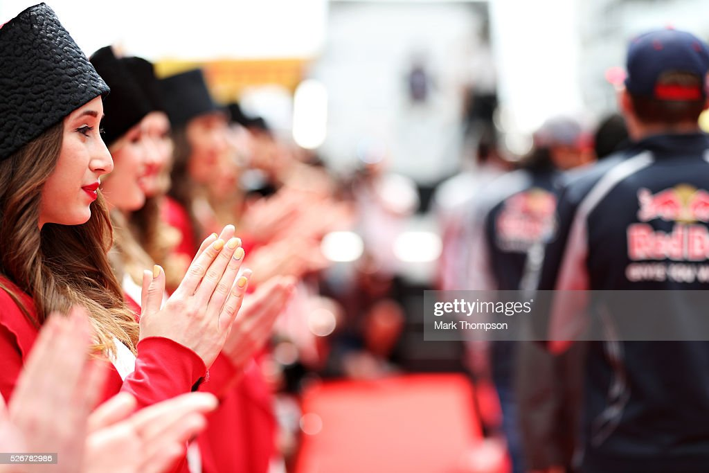 Grid girls applaud as the drivers come out for the drivers parade ahead of the Formula One Grand Prix of Russia at Sochi Autodrom on May 1, 2016 in Sochi, Russia.