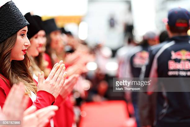 Grid girls applaud as the drivers come out for the drivers parade ahead of the Formula One Grand Prix of Russia at Sochi Autodrom on May 1 2016 in...