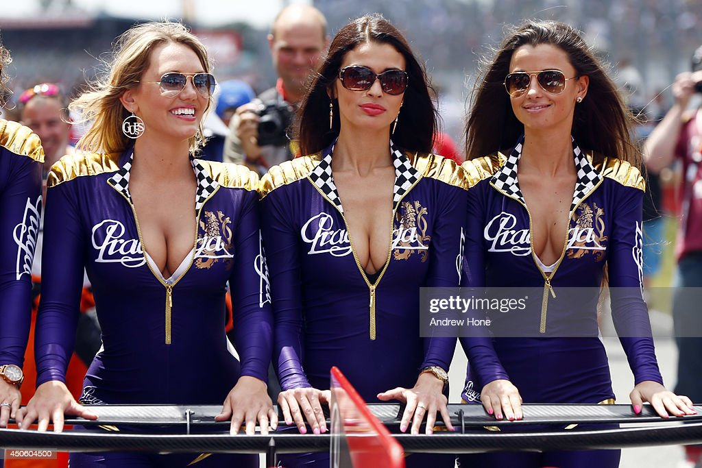 Grid Girls help push one of the cars on to the track at the Le Mans 24h Race on June 14 2014 in Le Mans France