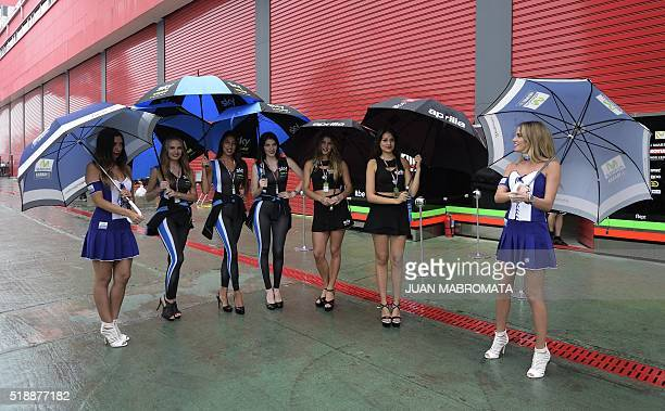 Grid girls pose at the pits before the warmup of the MotoGP of the Argentina Grand Prix at Termas de Rio Hondo circuit in Santiago del Estero...