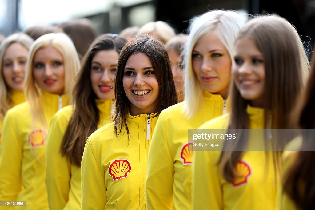 Grid girls pose before the Belgian Grand Prix at Circuit de Spa-Francorchamps at Circuit de Spa-Francorchamps on August 24, 2014 in Spa, Belgium.