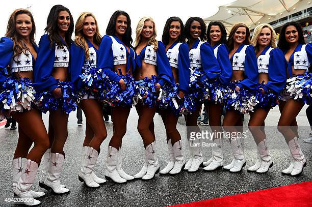 Grid girls pose before the drivers' parade ahead of the United States Formula One Grand Prix at Circuit of The Americas on October 25 2015 in Austin...
