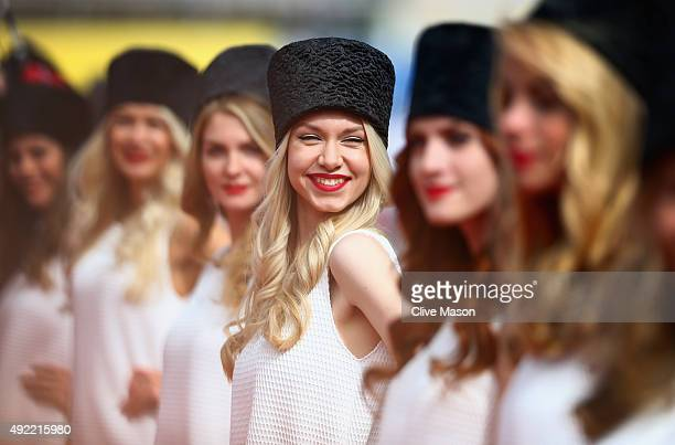Grid girls pose during the drivers' parade before the Formula One Grand Prix of Russia at Sochi Autodrom on October 11 2015 in Sochi Russia